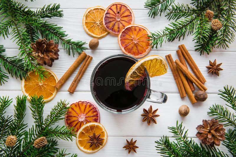 Christmas winter hot drinking with oranges, cinnamon and spice. Top view royalty free stock images