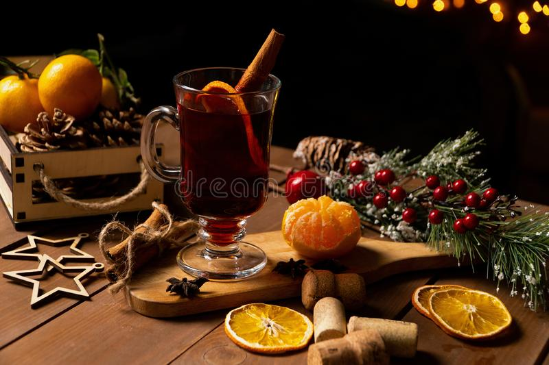 Christmas winter mulled wine from red wine with spices and fruit tangerines with cinnamon . Traditional alcoholic hot stock photography