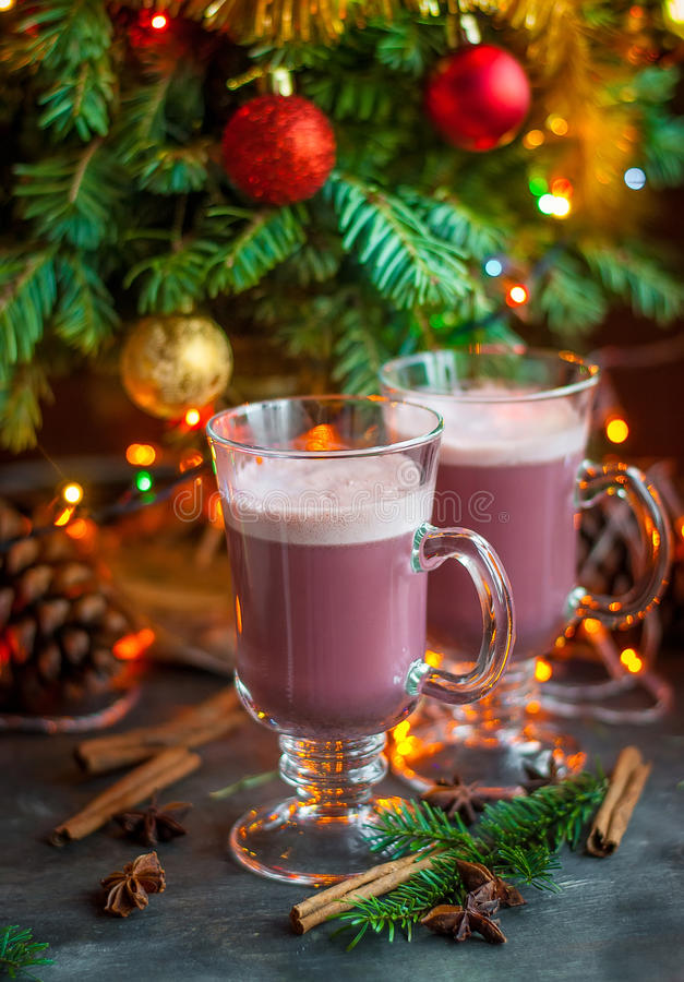 Christmas winter sweet hot alcohol drink mulled red wine glintwine with egg cream and spices. Vertical. Christmas winter sweet hot alcohol drink mulled red wine royalty free stock photography