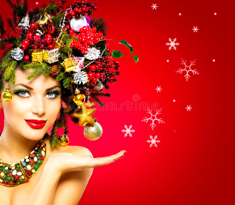 Christmas Winter Woman. Beautiful Christmas Holiday Hairstyle stock photography