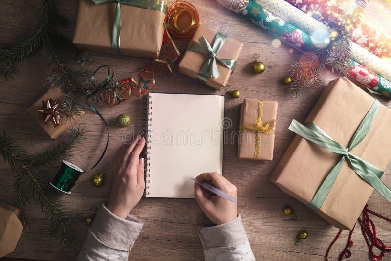 Christmas wish list on wood table background stock photo