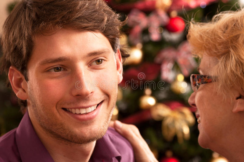 Christmas wishes in family. Christmas wishes from mother for son during christmas eve royalty free stock images