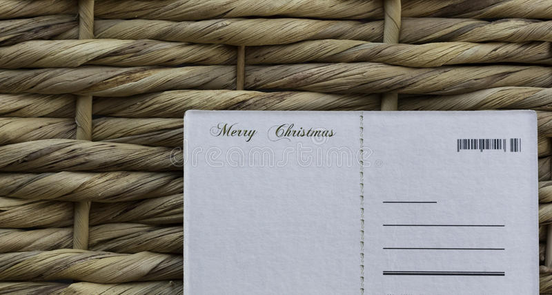 Christmas wishes postcard on a wicker background royalty free stock photos