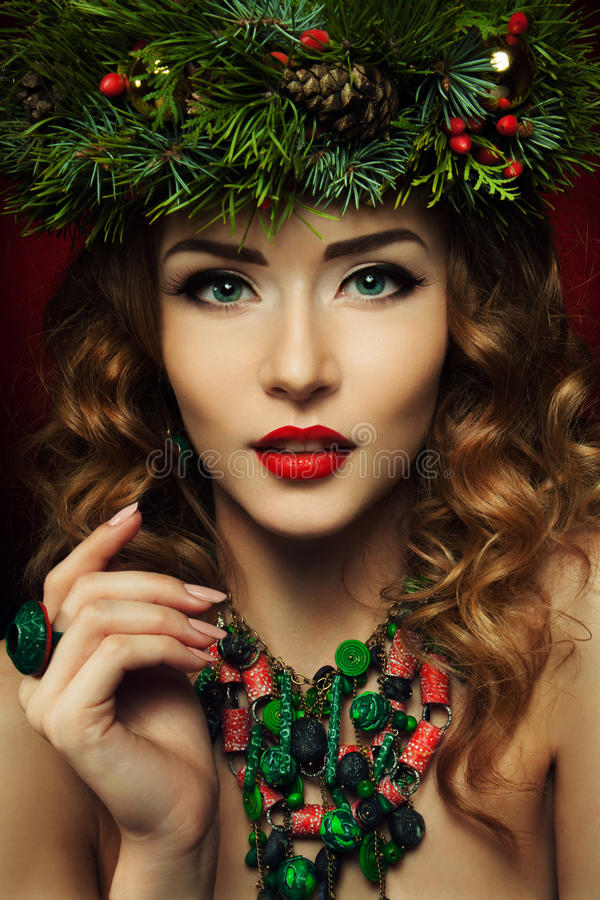 Christmas Woman. Beautiful Christmas wreath. New Year royalty free stock photos