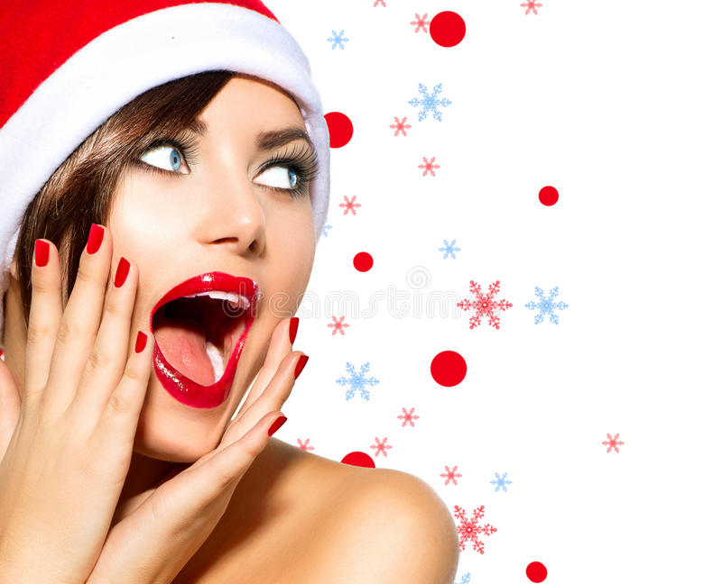 Christmas Woman. Beauty Model Girl in Santa Hat over White royalty free stock image