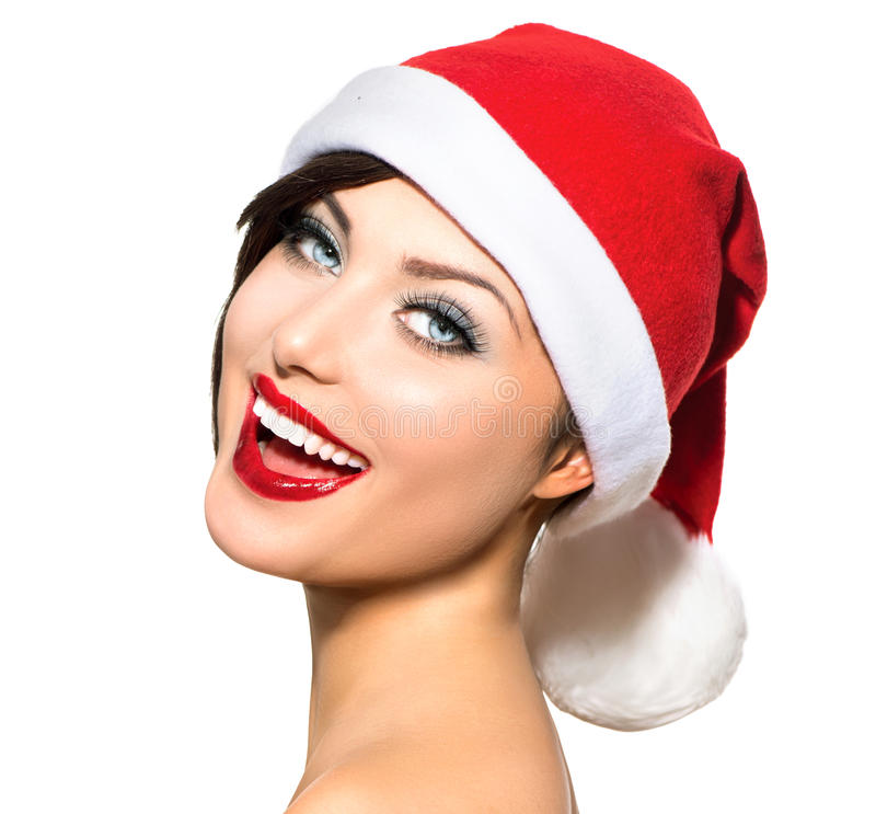 Christmas Woman. Beauty and Model Girl in Santa Hat stock photo