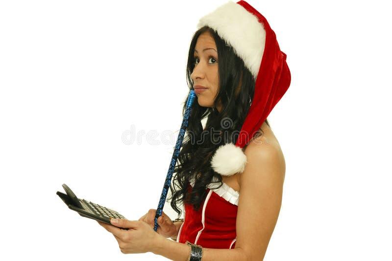 Christmas woman with calculator stock photos