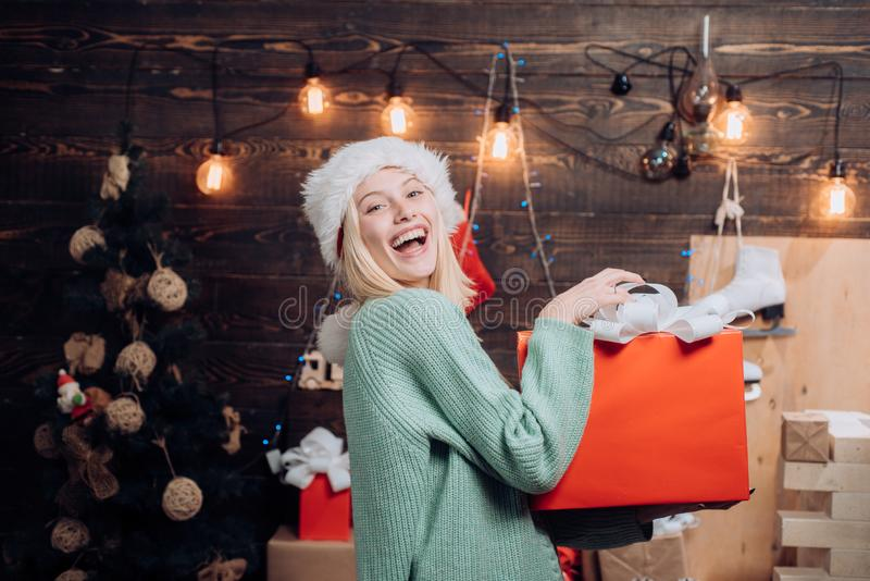 Christmas woman. Celebration. Funny. Portrait of a young smiling woman. New years eve girl. Cute young woman with santa stock images