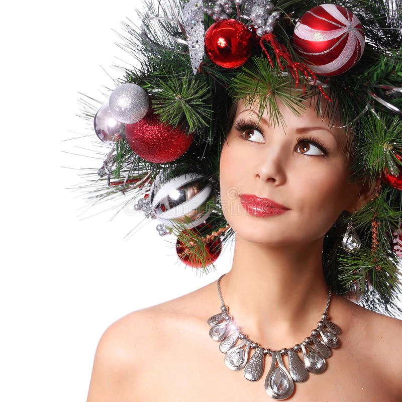 Christmas Woman. Fashion Girl with New Year Decorated Hairstyle. Portrait of Beautiful Model with Red Christmas Balls stock photo