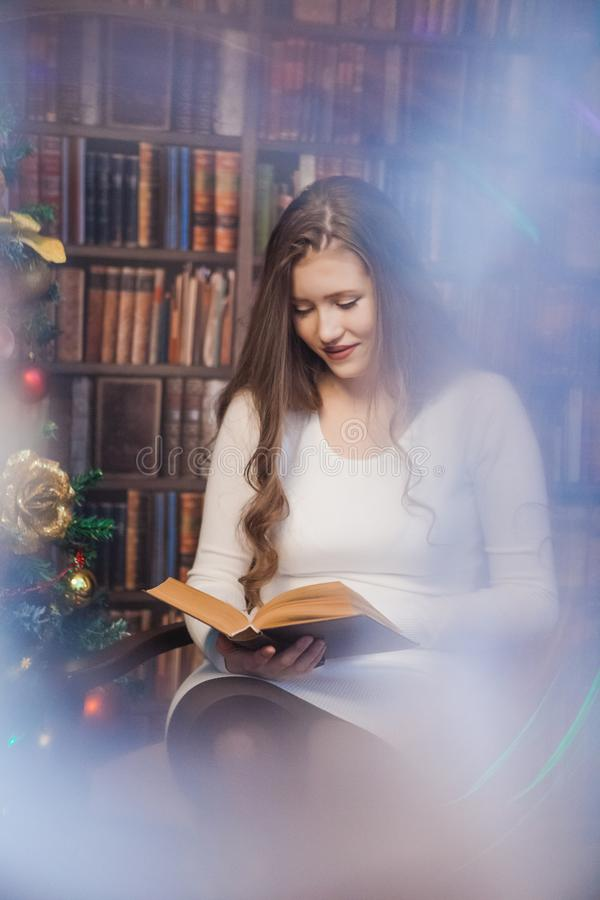 Christmas woman. Happy smiling girl celebrating New Year at Home. royalty free stock image