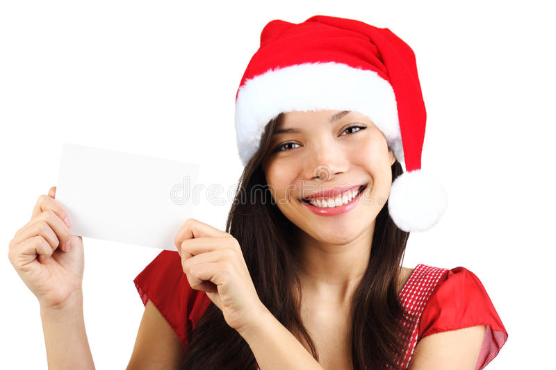 Christmas woman holding blank paper sign. Very beautiful mixed race asian / caucasian woman smiling. Isolated on white background royalty free stock photo