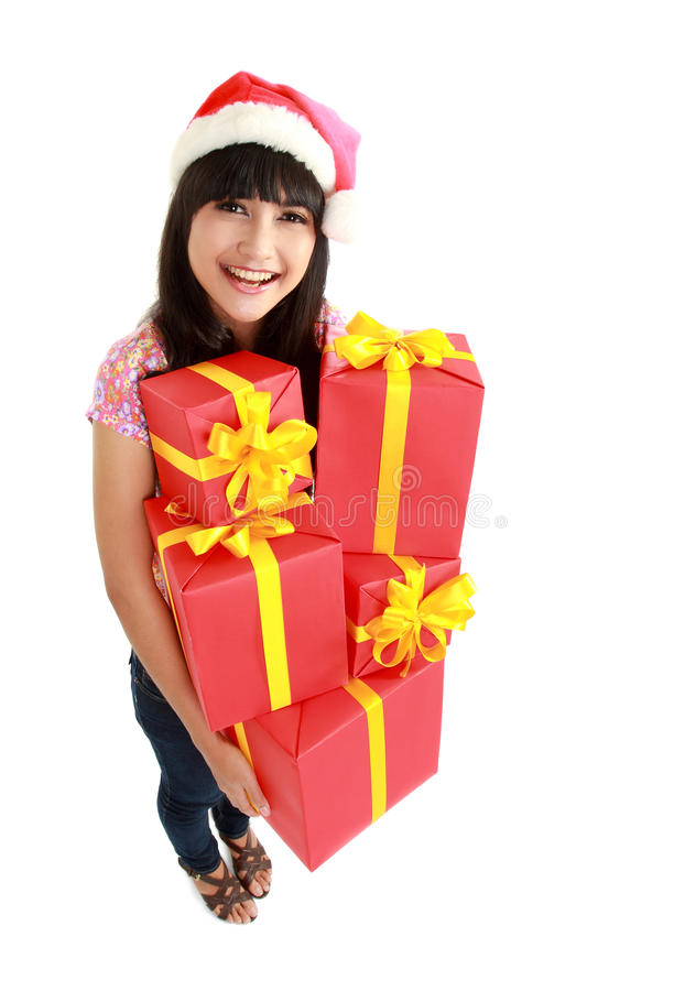 Christmas woman holding gifts wearing Santa hat