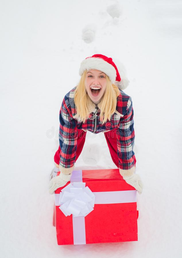 Christmas Woman holding a huge gift box. Woman present red gift box with ribbon bow isolated over white background. Big stock photos