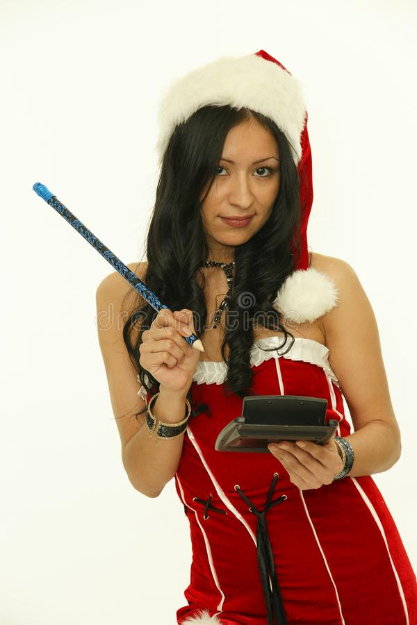Christmas woman holding pencil and calculator stock photography