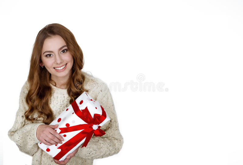 Christmas woman holding present excited.wearing stock photo