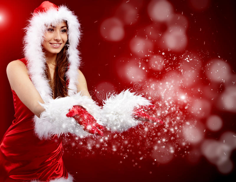 Christmas woman holding star. Young christmas woman holding star over red background stock photography