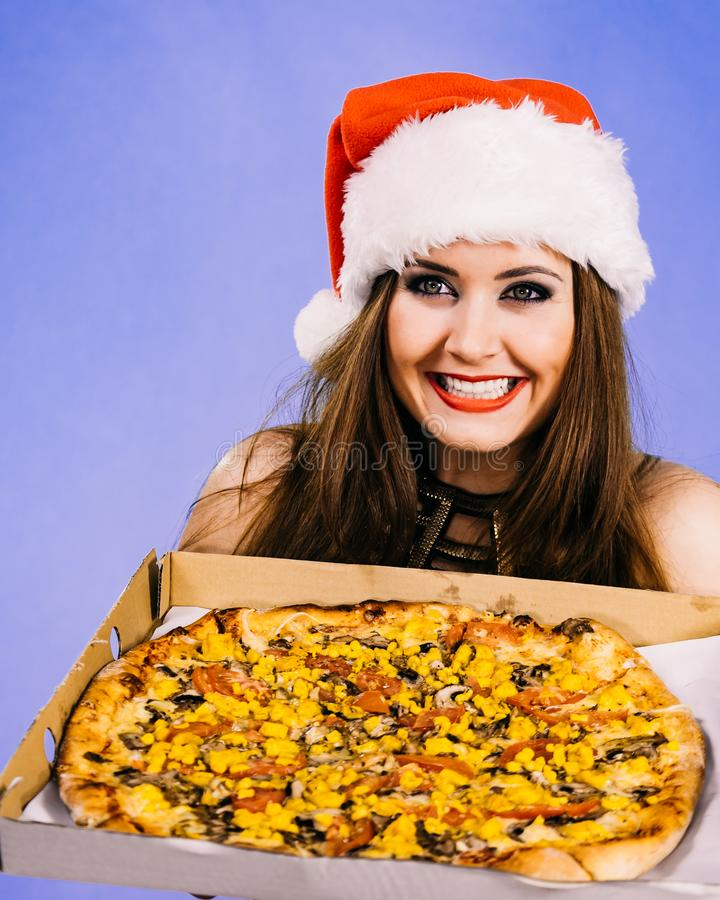 Christmas woman holds pizza in box royalty free stock photography