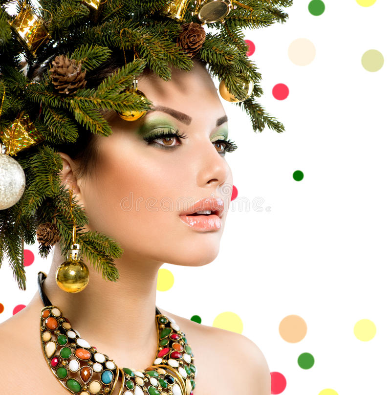 Christmas Woman. Christmas Holiday Hairstyle and Makeup royalty free stock photo