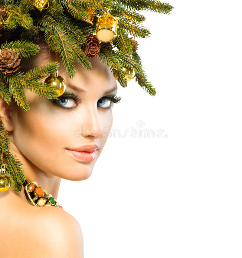 Christmas Woman. Christmas Holiday Hairstyle and Makeup royalty free stock photography