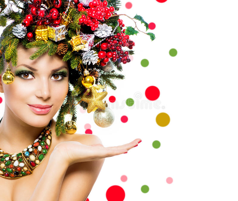 Christmas Woman. Christmas Holiday Hairstyle and Makeup royalty free stock images