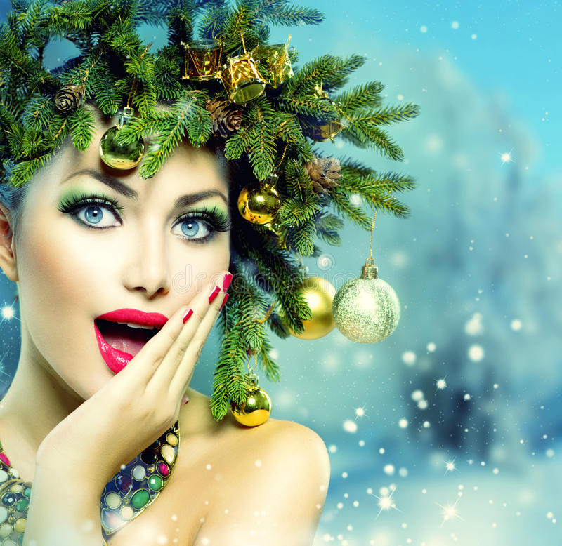 Christmas Woman. Christmas Holiday Hairstyle and Makeup royalty free stock photos