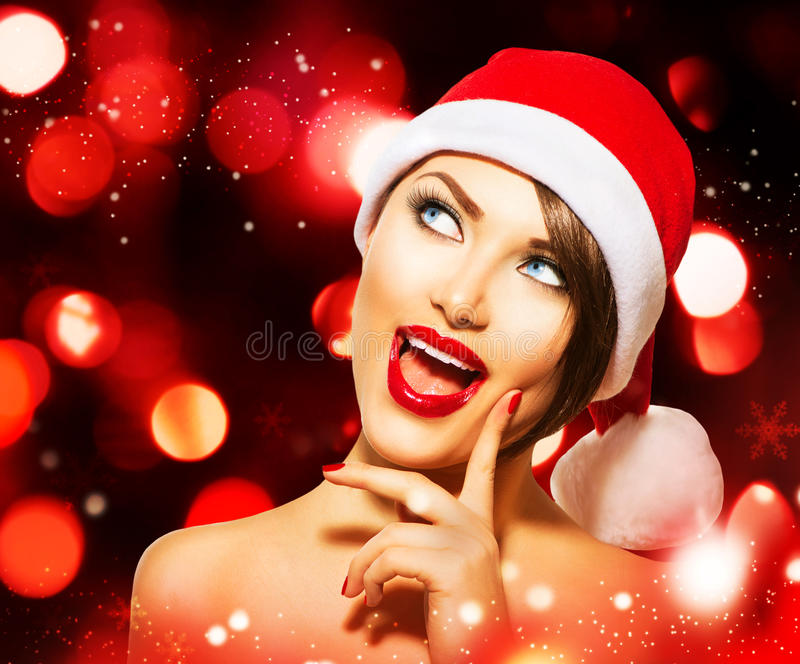 Christmas Woman. Over Glowing Holiday red Background stock photo