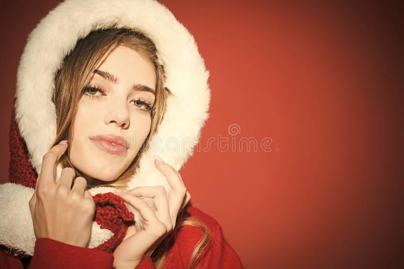 Christmas woman in red hood, copy space. New year and christmas. Woman in santa costume with pretty face. Happy girl celebrate new year on red background. Xmas royalty free stock photos