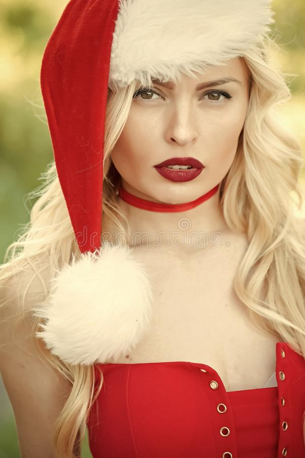 Christmas woman with red lips. Woman in santa hat, greeting and preparation. Christmas time. Xmas party, winter holiday. girl celebrate new year royalty free stock photos