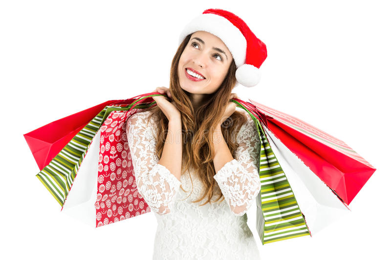 Christmas woman with shopping bags looking to copy space royalty free stock image
