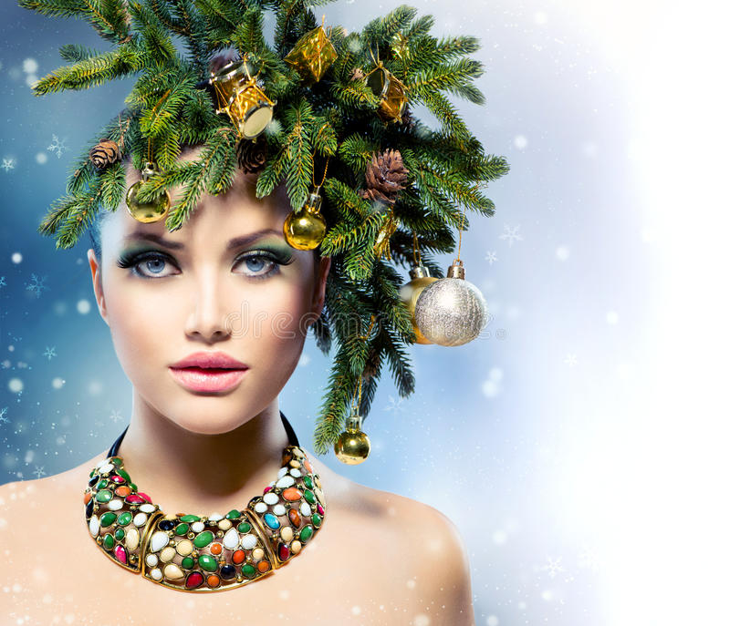 Christmas Woman. Christmas Tree Holiday Hairstyle and Makeup stock images