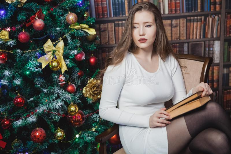 Christmas woman. Happy smiling girl celebrating New Year at Home. royalty free stock photos