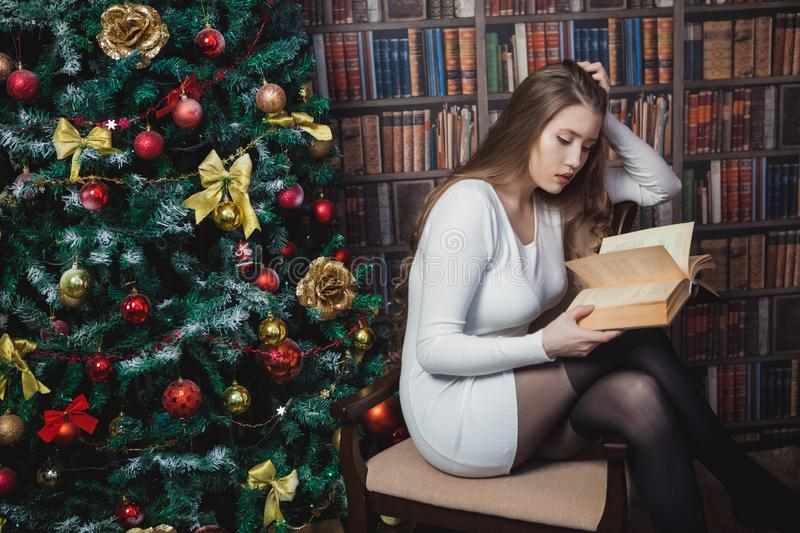 Christmas woman. Happy smiling girl celebrating New Year at Home. royalty free stock images