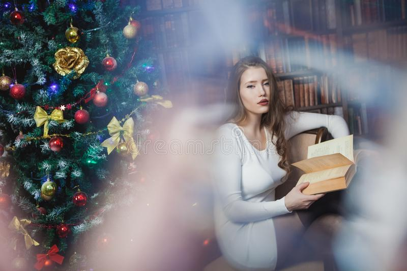 Christmas woman. Happy smiling girl celebrating New Year at Home. stock photos