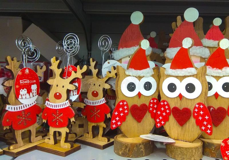 Christmas wooden animal toys deer and owls. Russian Christmas Market, oldest Christmas fairs. Christmas wooden animal deer and owls. Russian Christmas Market royalty free stock photography