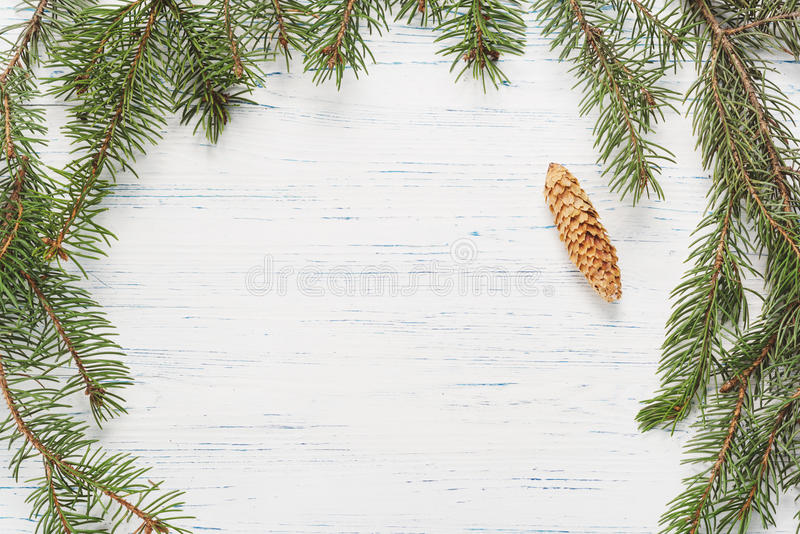 Christmas wooden background with fir branches. Wooden background stock illustration