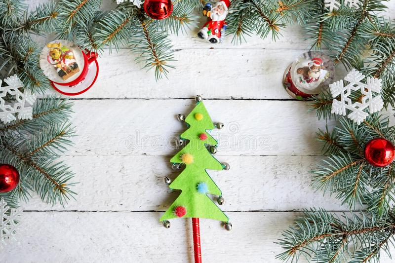 Christmas wooden background with fir tree and decoration, new yaer toys royalty free stock photos