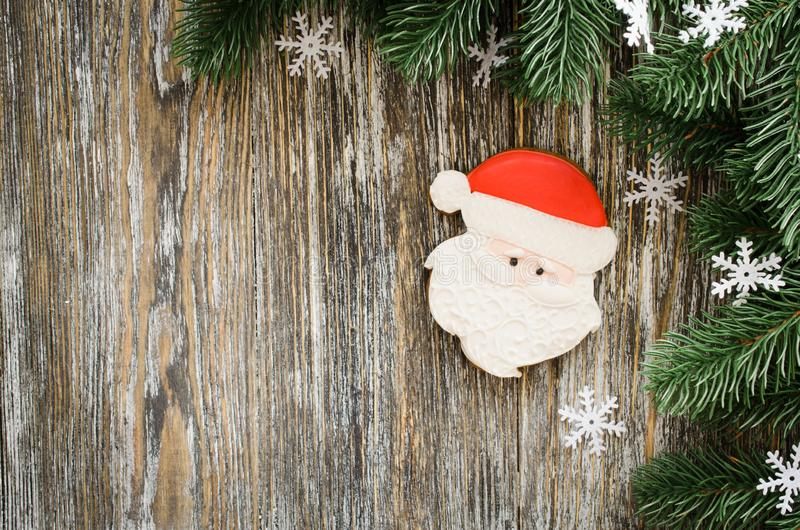 Christmas wooden background with fir tree and gingerbread Santa stock photo