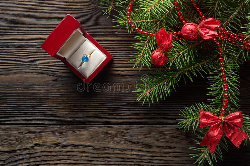 Christmas wooden background with fir tree stock photography