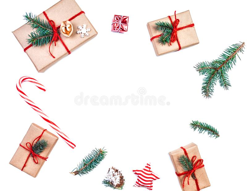 Christmas wooden background with gift boxes, pine cones, fir bra royalty free stock image