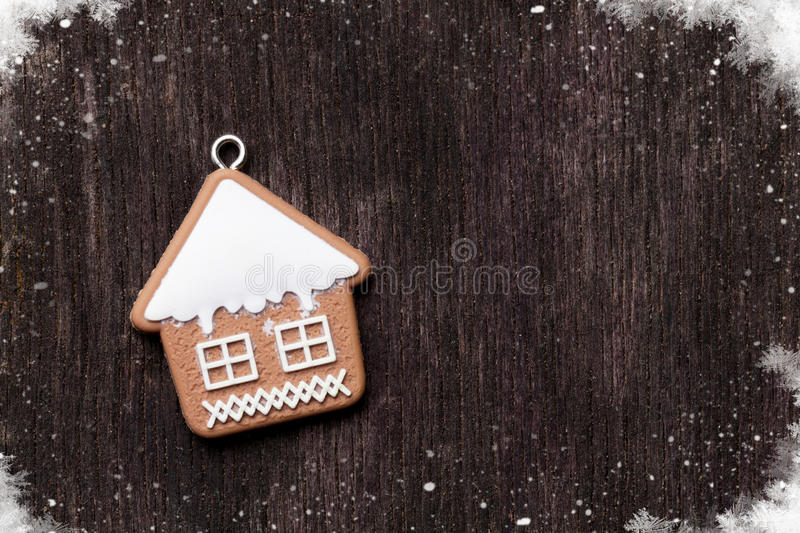 Christmas wooden background with gingerbread cookie house royalty free stock photo