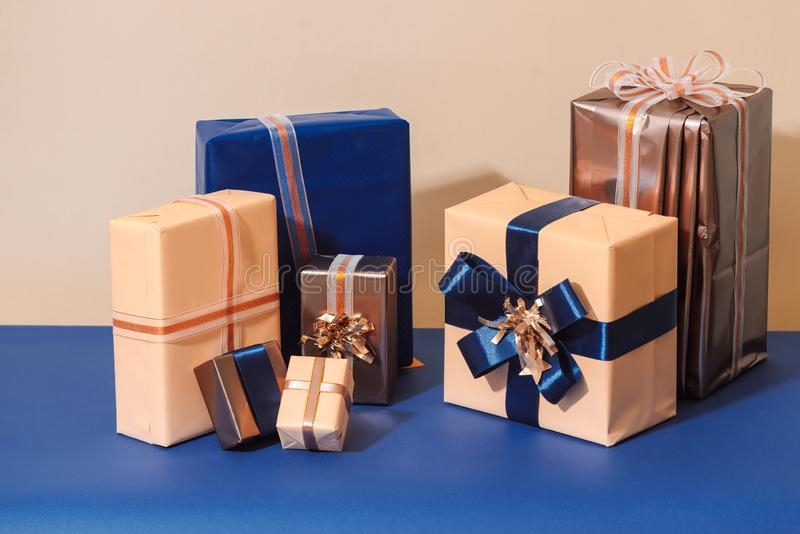 Christmas wrapped gift boxes on blue background.  stock photo