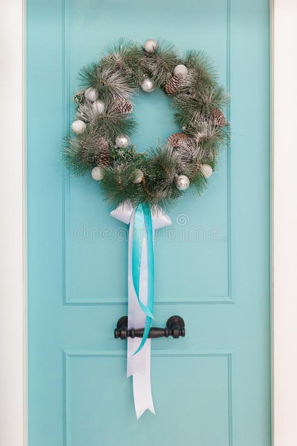 Christmas wreath on the background of the turquoise door stock photo
