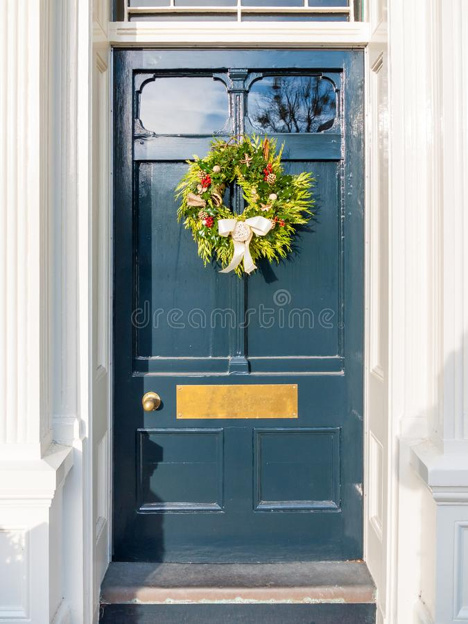 Christmas Wreath On Blue Country Front Door House Stock Image