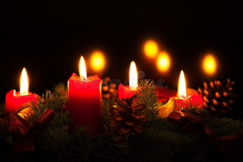 Christmas wreath with burning red candles, advent time. Sign. Countdown to christmas. Every sunday burn one candle royalty free stock image