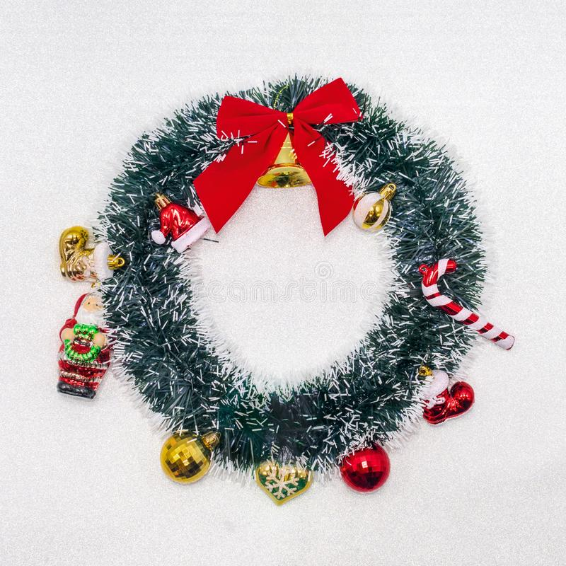 Christmas wreath decoration on white silver glitter sparkle back. Ground. Flat lay with copy space royalty free stock photos