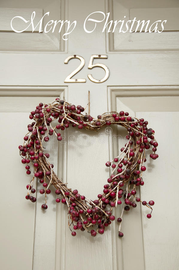 Download Christmas wreath on a door stock image. Image of banner - 27019657