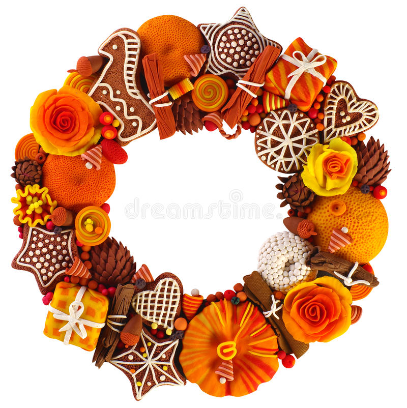 Christmas wreath at the door, gift, with cinnamon and citrus, made in plasticine technique stock photos