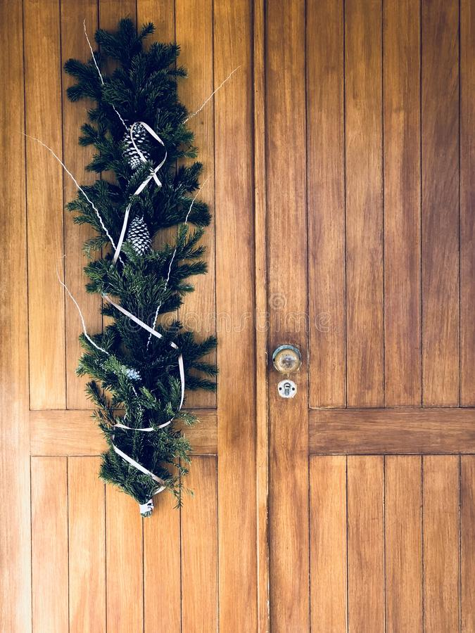 Christmas wreath on front door. A home made Christmas wreath hanging on the front door stock images