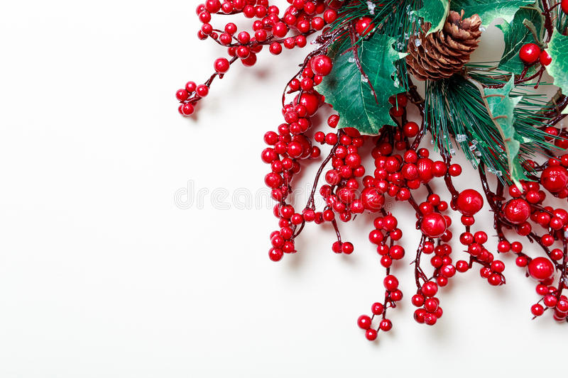 Christmas wreath of holly berries and evergreen isolated on white background. Christmas and new year wreath of Holly berries and evergreen isolated on white stock photos