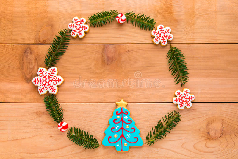 Christmas wreath with homemade cookies on wooden table. Christmas wreath with homemade cookies on wooden table, top view stock photography